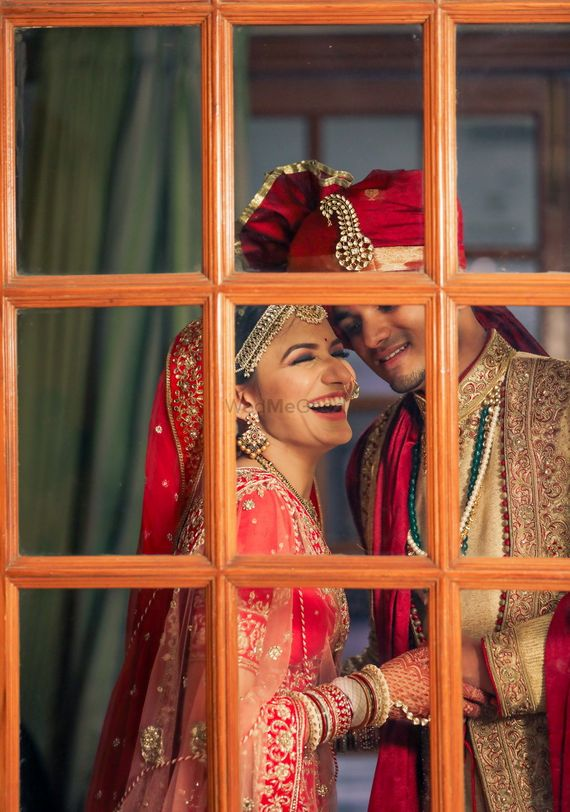 Photo of cute and happy couple portrait with happy bride