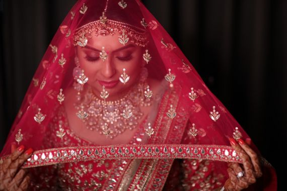 Photo of Red net dupatta as a veil.