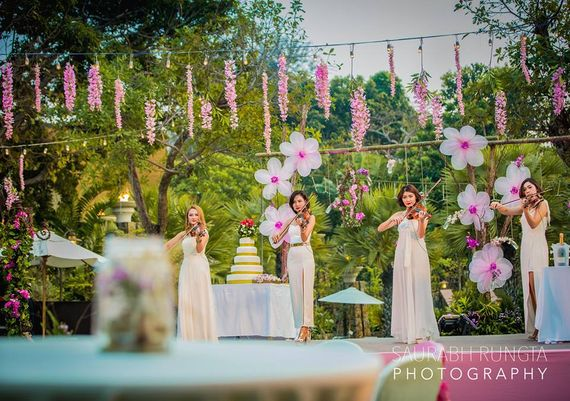Photo of Purple and White Floral Day Themed Decor