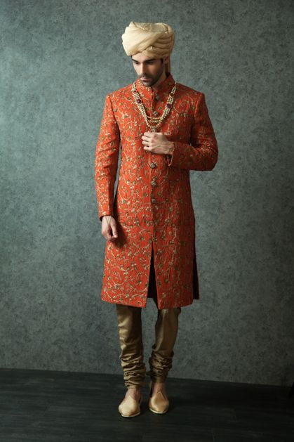 Photo of Orange Sherwani with Copper Churidar and Gold Pagdi