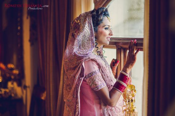 Photo of Pink Sikh Bride Shot with Chooda and Kaleere
