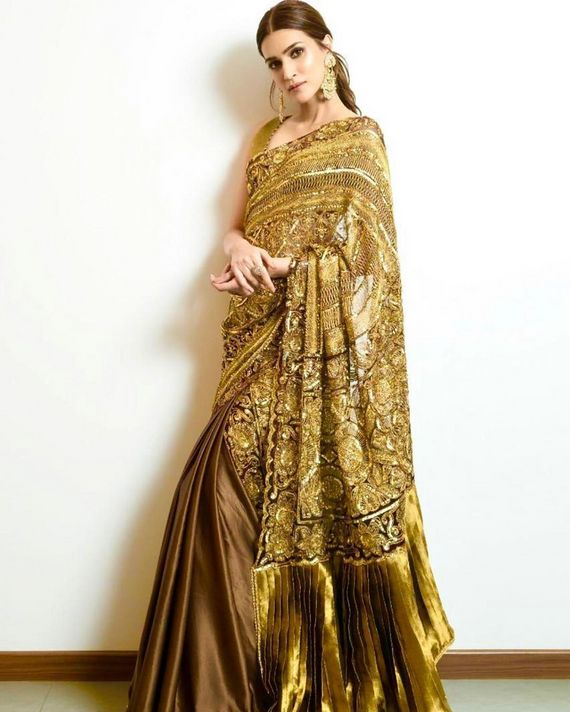 Photo of Copper and gold saree with hint of green and heavy palla.