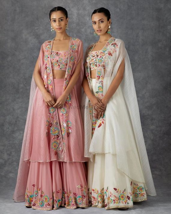 Photo of Whit and Pink lehengas with cape style dupatta. Suits well for gromm's or bride's sister.