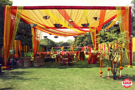 Photo of Yellow and Orange Tents with hanging Floral Decor
