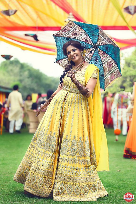 Photo of Light Yellow and Gold Anarkali Bride with Umbrella