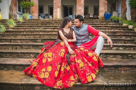 Photo of Red lehenga floral printed by Sabyasachi