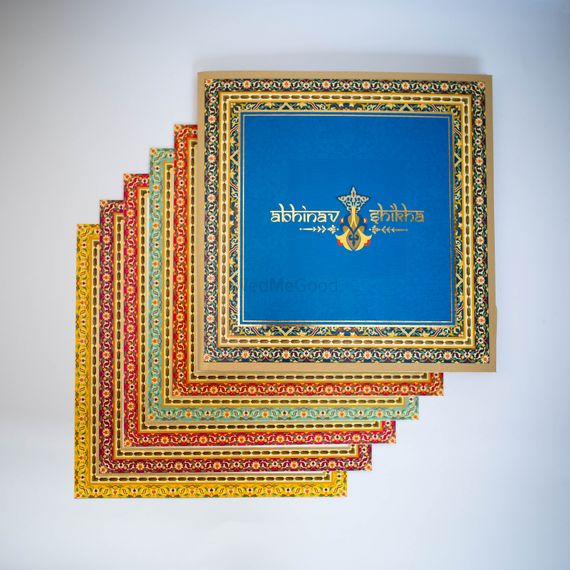 Photo of multicolored square invitation cards
