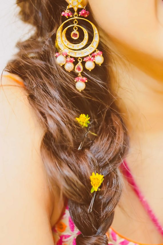 Photo of braid hairstyle with petals