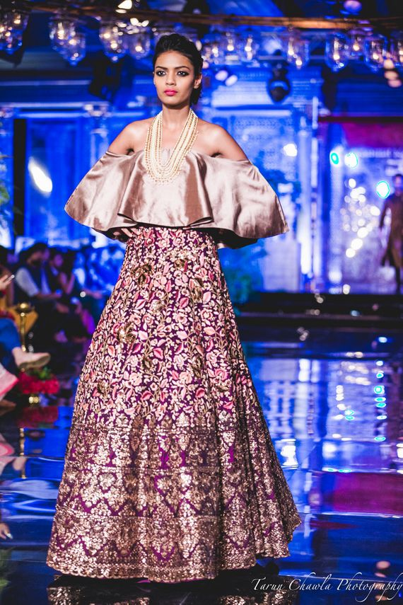 Photo of Purple Lehenga with Gold embroidery and Thread Work