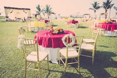 Photo of Round Table Setting with  White Floral Wreaths