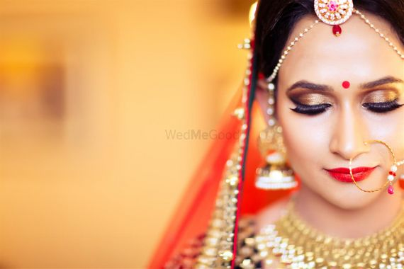 Photo of Brown Bridal Eye Makeup Paired with Red Lips
