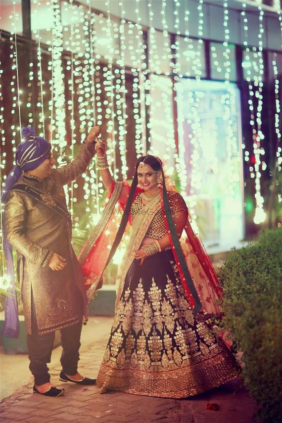 Photo of Blue and Red Bridal Lehenga with Gold Work