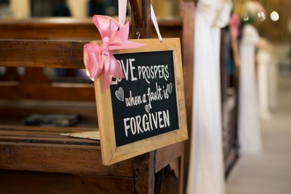 Photo of Chalkboard Love Message at Wedding Aisle