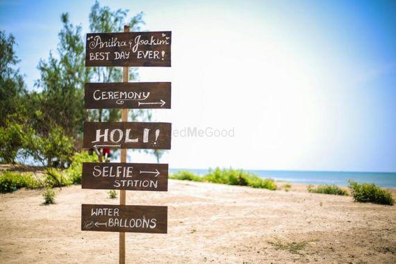 Photo of Fun Chalkboard Direction Board for Beach Wedding