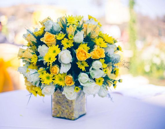 Photo of Yellow and white flowers with roses