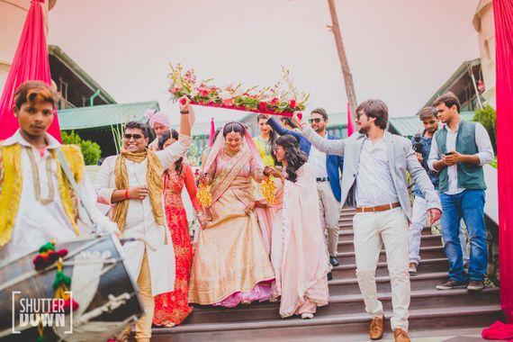 Photo of Fun Bridal Entry Under Rustic Phoolon ki Chadar