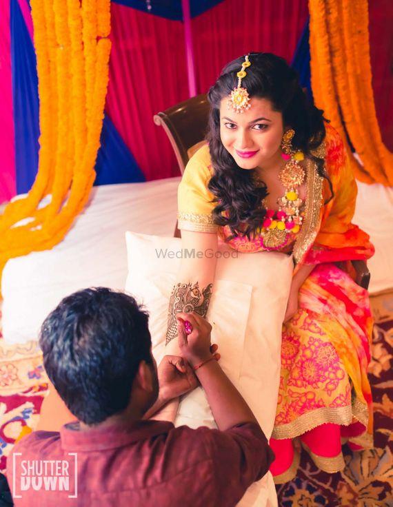 Photo of Bride Getting Mehendi with Gota and pompom Jewellery