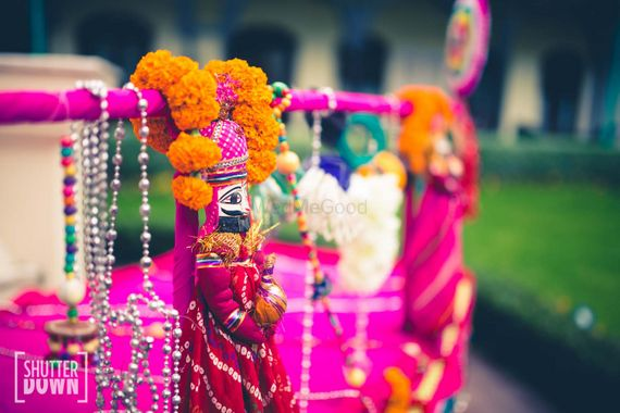 Photo of Pink Puppets with Genda Phool Arrangement for Mehendi
