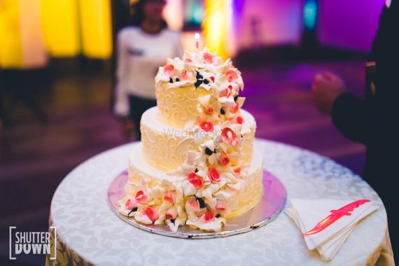 Photo of 3 Tiered Parisian Wedding Cake with Lace Pattern