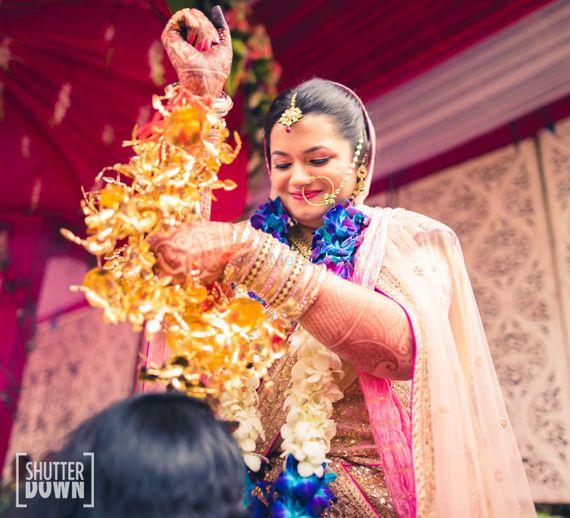 Photo of Bride Showering Kaleere on Bridesmaids