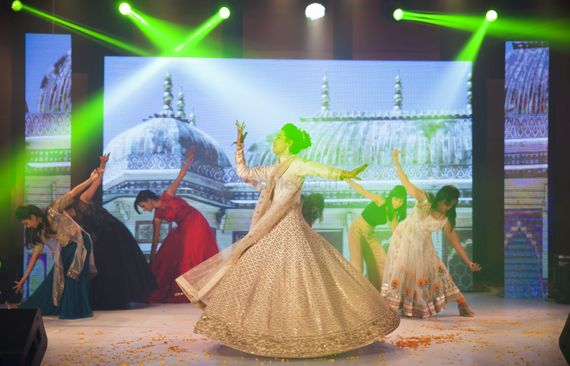 Photo of Bride Dancing on Stage During Sangeet