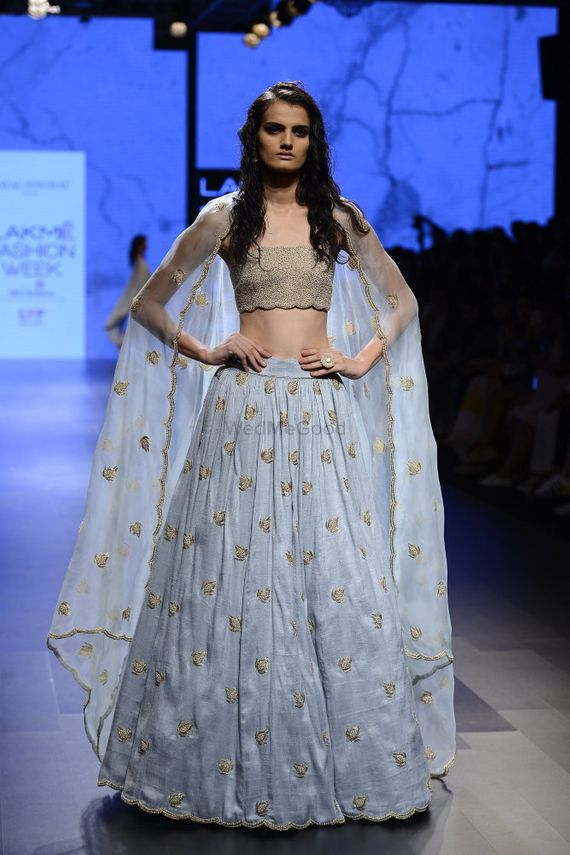 Photo of Light Grey Cape Lehenga with Metallic Motifs and Blouse