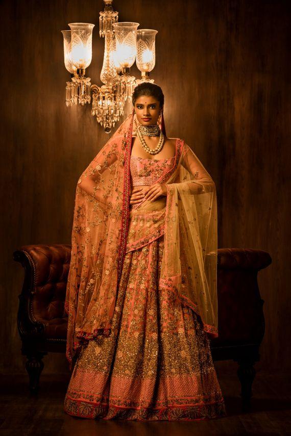 Photo of Light ink and gold bridal lehenga
