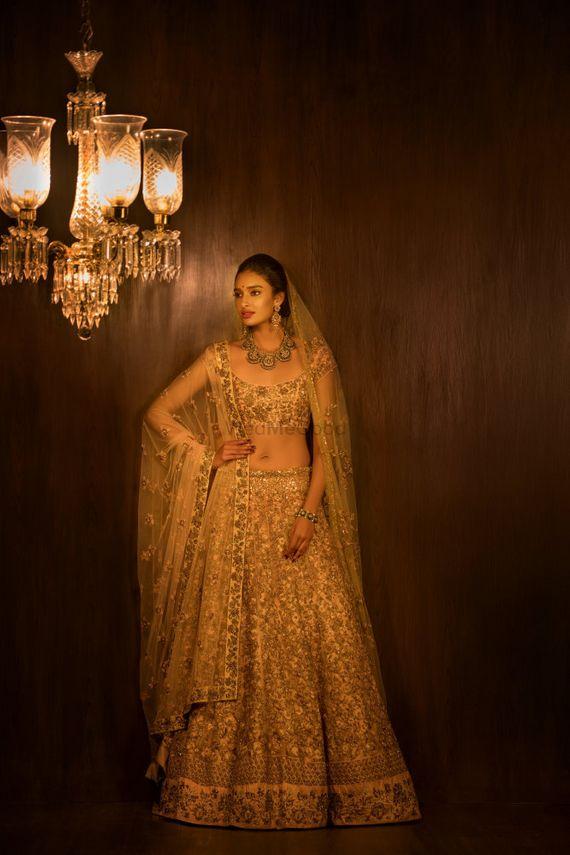 Photo of Gold bridal lehenga