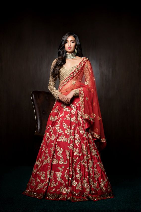 Photo of Red and gold bridal lehenga