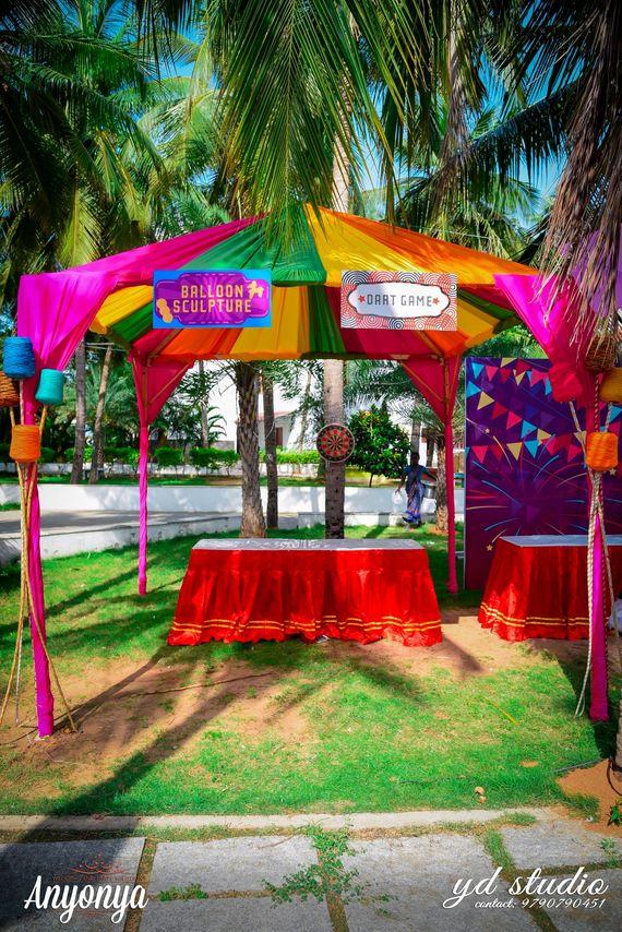 Photo of Balloon Sculpture and Dart Game at Destination Wedding