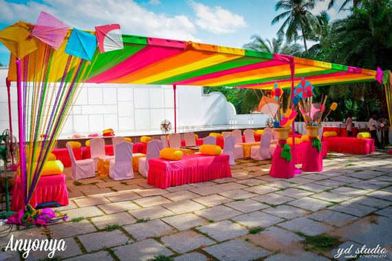 Photo of Colourful Mehendi Decor with Kites and Origami