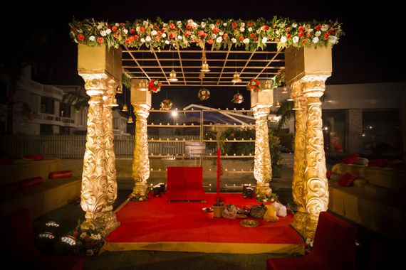 Photo of Gold Temple Theme Mandap with Jali and Flowers