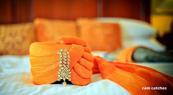 Photo of Embellished safa for groom in orange