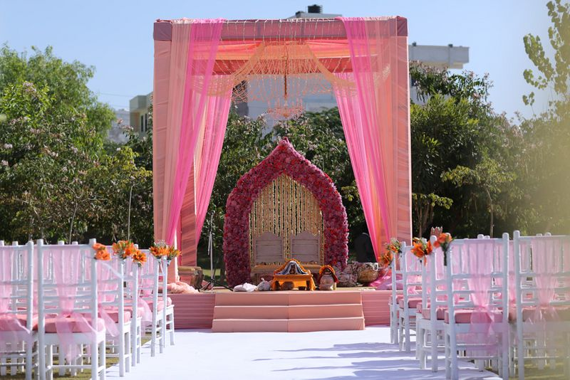 Outdoor Morning Sikh Wedding Decor With Pink Drapes