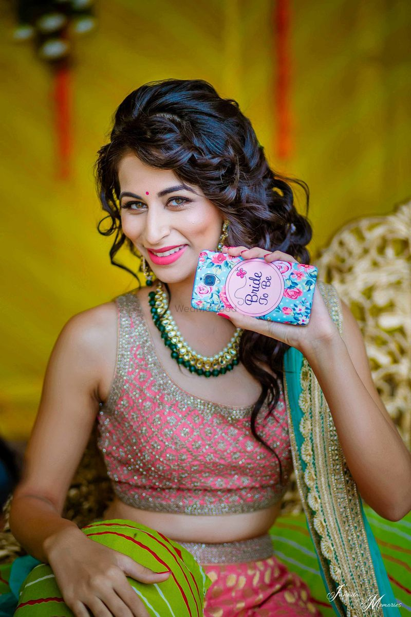Photo of Bride showing off bride to be phone cover