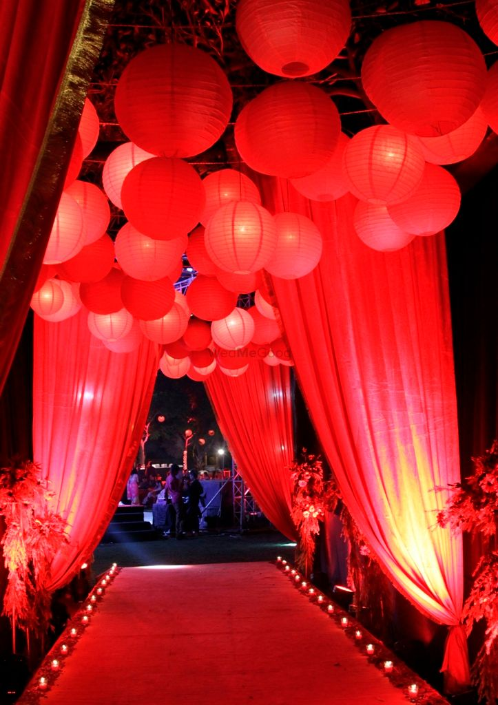 Photo of Red lamps at entrance way hanging lamps from the ceiling with drapes and red