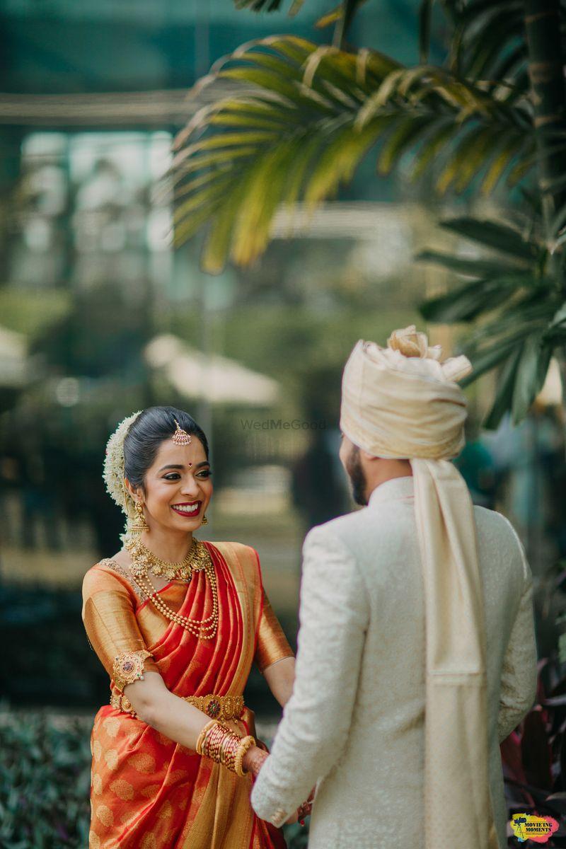 Photo of Happy bride in orange kanjivaram saree