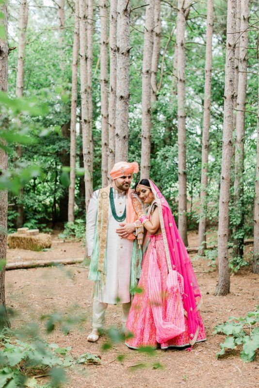 A Cross Culture Wedding With Stunning Decor And A Bride In Pink & Blue Lehenga