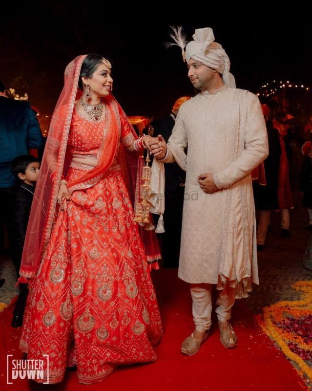 A Stunning Palace Wedding With The Bride In A Unique Orange Lehenga