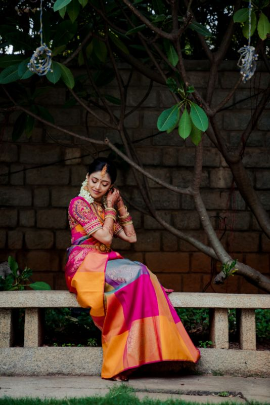 A Colourful Bangalore Wedding With The Bride In A Multi-Hued Silk Saree