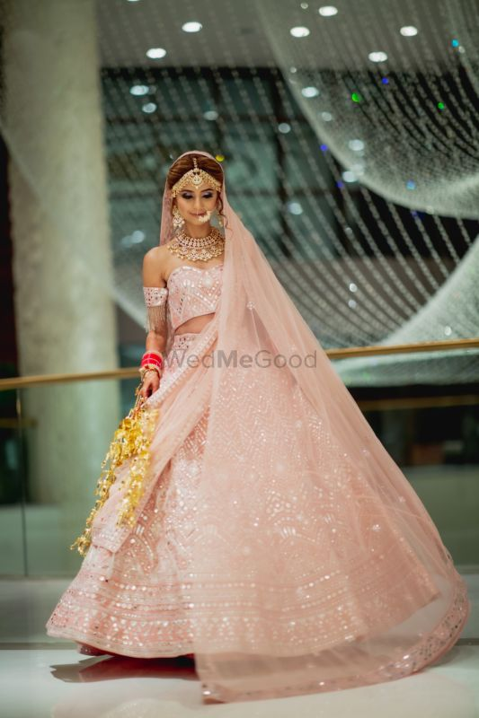 A Dubai Wedding With The Bride In A Pastel Pink Lehenga With An Off Shoulder Blouse